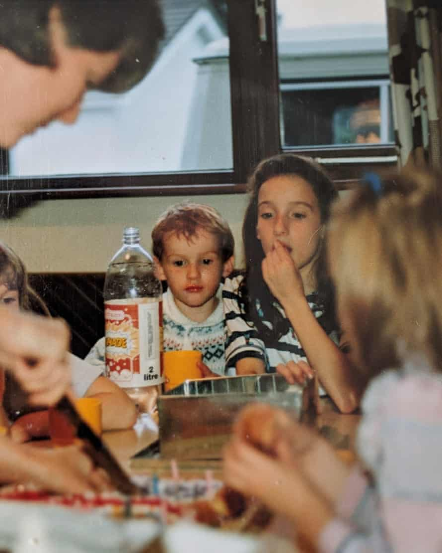 Teatime and sympathy: Séamas sits with his sister Orla for lemonade and biscuits in 1989.