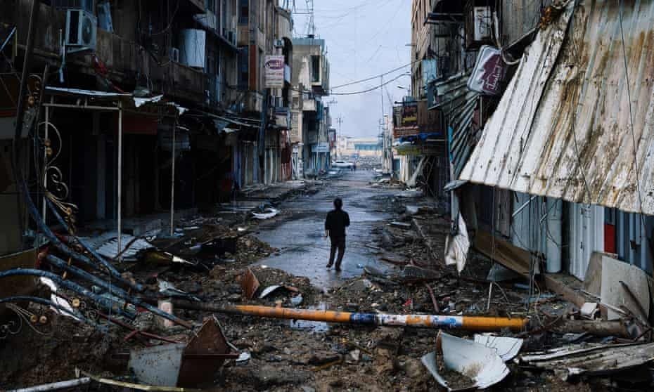 An Iraqi boy walks down a street near Mosul's University on January 22, 2017, a week after Iraqi counter-terrorism service retook it from Isis.