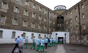 Prisoners return from their jobs to their wings for lunch at Wandsworth prison.