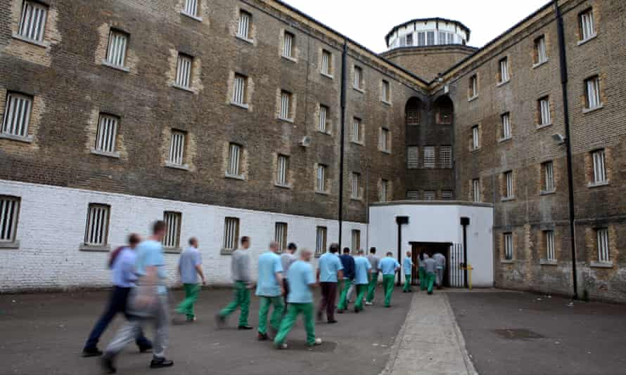 Prisoners return to their wings for lunch at Wandsworth prison.