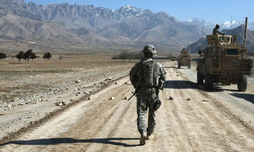 A US soldier walks along a road under-construction near Bagram, about 60 km from Kabul in 2010. Afghans who helped US forces during the 20-year war fear for their safety after American withdrawal.