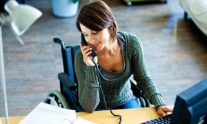 Woman in wheelchair working.