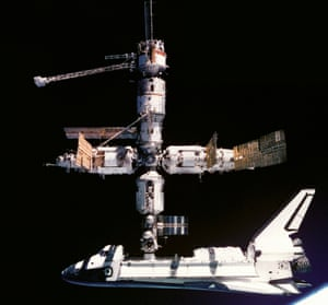 The space shuttle Atlantis docking with the Mir space station