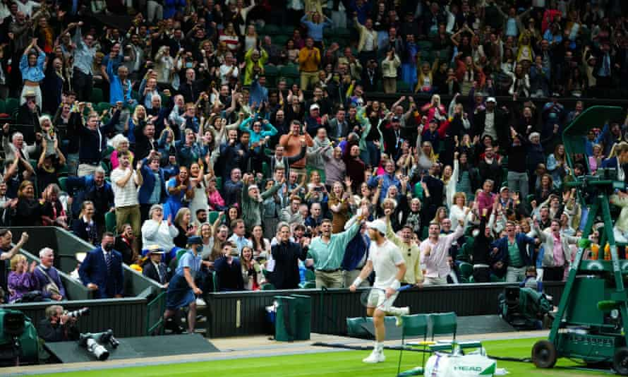 Andy Murray celebrates in front of the Centre Court crowd after winning a point during his five-set win against Oscar Otte.