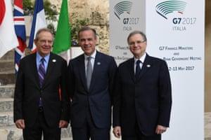 Italian Economy Minister Pier Carlo Padoan (left), Bank of England governor Mark Carney (centre) and Bank of Italy Governor Ignazio Visco (right).