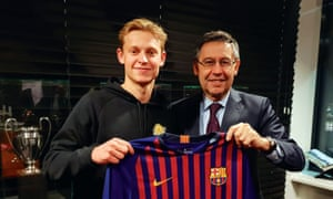 Josep Maria Bartomeu poses with Frenkie de Jon after the brilliant Ajax midfielder signed a deal to move to the Camp Nou this summer in a deal that could rise to £75m.