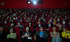 People wear 3D glasses at a cinema in Taiyuan, Shanxi province