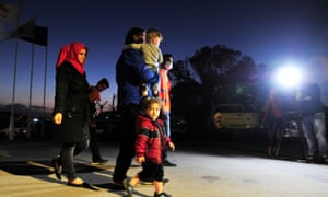 Syrian refugees arrive at a designated accommodation area near Nicosia, Cyprus.