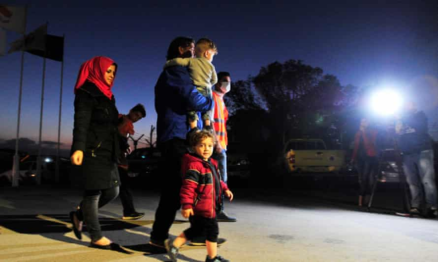 Syrian refugees arrive at a designated accommodation area near Nicosia, Cyprus.