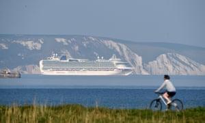 Cruise ship MV Ventura of the P&O Cruises fleet is anchored in the bay in Weymouth.