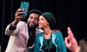 Ilhan Omar celebrates with one of her supporters after winning Minnesota for the Democrats