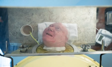 Paul Alexander, reflected in a mirror attached to his iron lung, Thursday, September 12, 2019, in his apartment in Dallas, Texas.