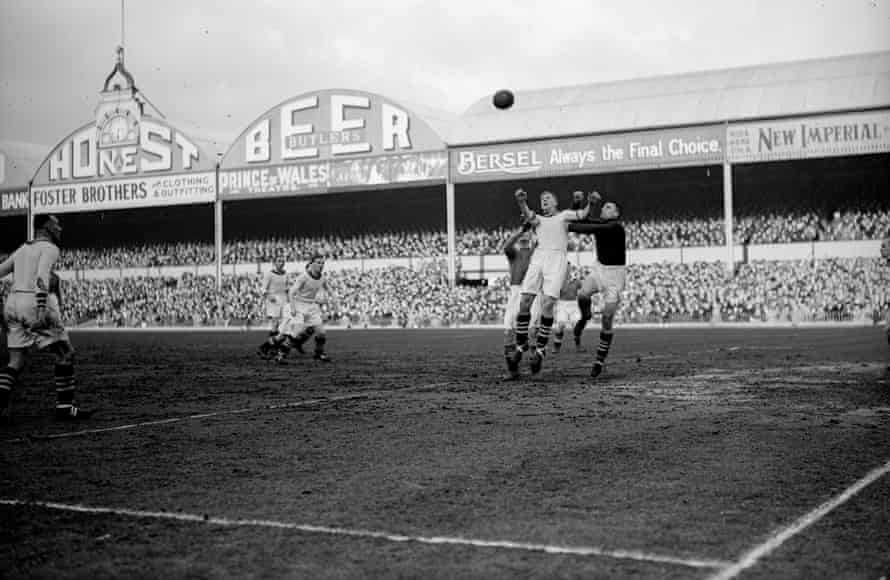 A high ball, of the brown leather variety, is lofted into the area during an Aston Villa match at Villa Park circa 1928.