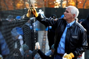 Washington, USVice President Mike Pence cleans the wall that is inscribed with the names of fallen servicemen at the Vietnam Veterans Memorial