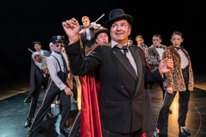 Julius D'Silva as Max Bialystock, with the cast of The Producers in 2018, directed by Raz Shaw and designed by Ben Stones.