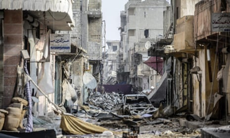 Wreckage left by fighting on a street in the centre of of Kobani on Wednesday