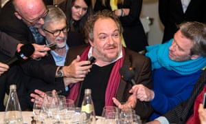 Mathias Énard answers questions after receiving the award at Drouant restaurant.