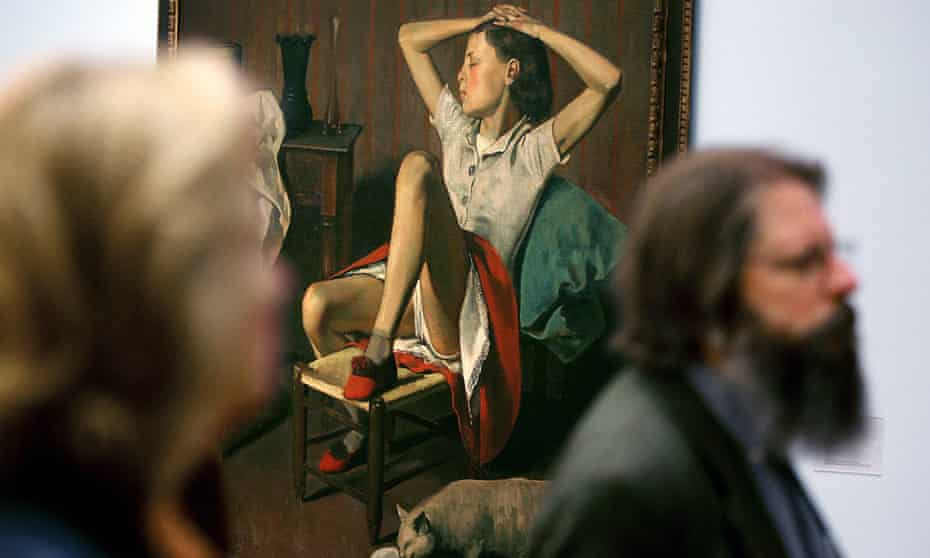 Visitors pass by the painting Therese Dreaming by Balthus, born Balthasar Klossowski.