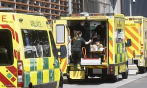 Ambulances arrive at the Whitechapel hospital in East London. The UK has reported over 50,000 new Covid cases in the past day.