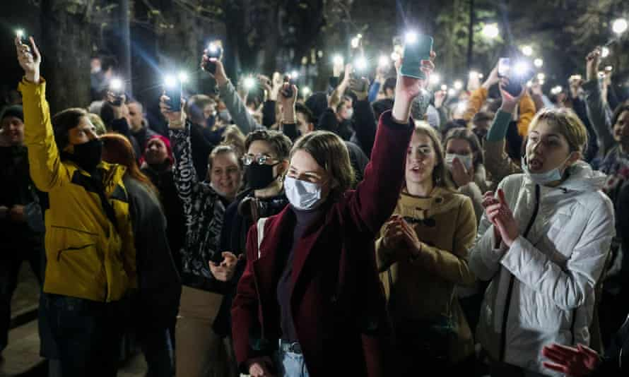 Supporters of opposition activist Navalny shine mobile torches as they take part in an unsanctioned rally in Rostov On Don, Russia.