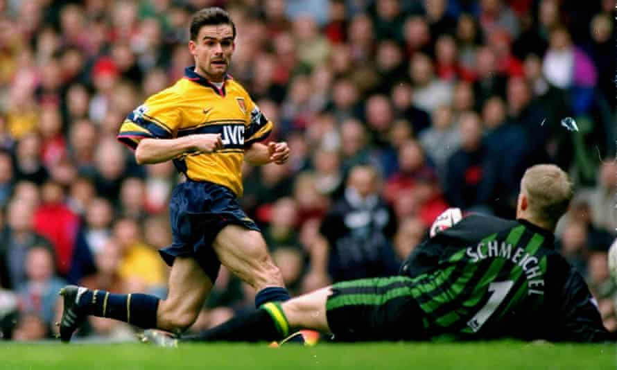 Marc Overmars scores Arsenal's 79th-minute winner against Manchester United at Old Trafford on 14 March 1998 which swayed the title race in the Gunners' favour.