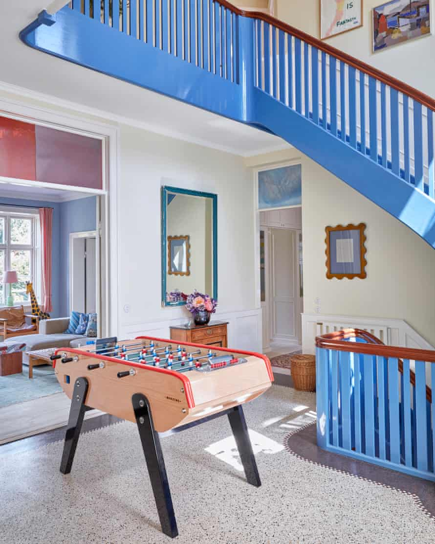 Top table: football game, cornflower-blue staircase.