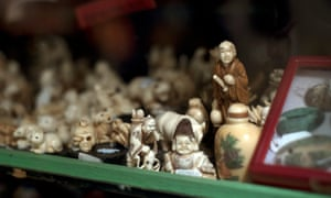 Mammoth ivory carvings on display in a Hong Kong antique shop
