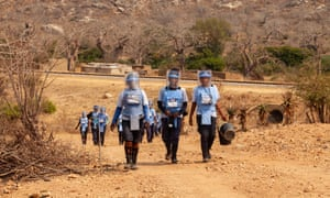The team head back into the minefield after the explosive they found was detonated.