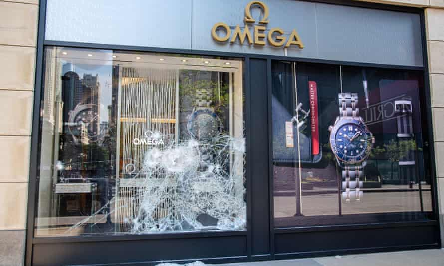 Broken windows are seen at an Omega following a night of civil unrest and looting in downtown Chicago.