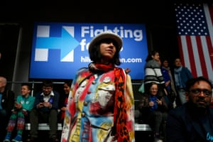 A Hillary Clinton supporter wears a suit imprinted with her image at her presidential primary night rally in New York.