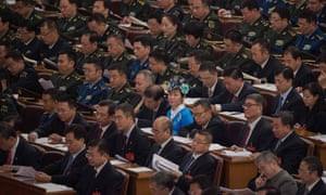 Delegates listen to Chinese president Xi Jinping's address.