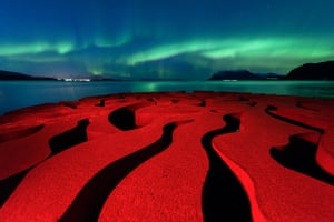 Seven Magic Points Rune Engebø (Norway) The rusty red swirls of the circular, iron sculpture Seven Magic Points in Brattebergan, Norway mirror the rippling aurora above.