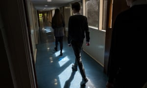 Pupils socially distance as they walk between classes