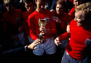 England players (L-R) Roger Hunt, Geoff Hurst, Jack Charlton (holding cup), Alan Ball, Bobby Charlton and captain Bobby Moore admire the Jules Rimet trophy following their victory over West Germany.
