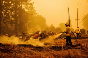 Oregon firefighters put out embers in Mill City, Oregon, on 10 September 2020, as they battle the Santiam fire