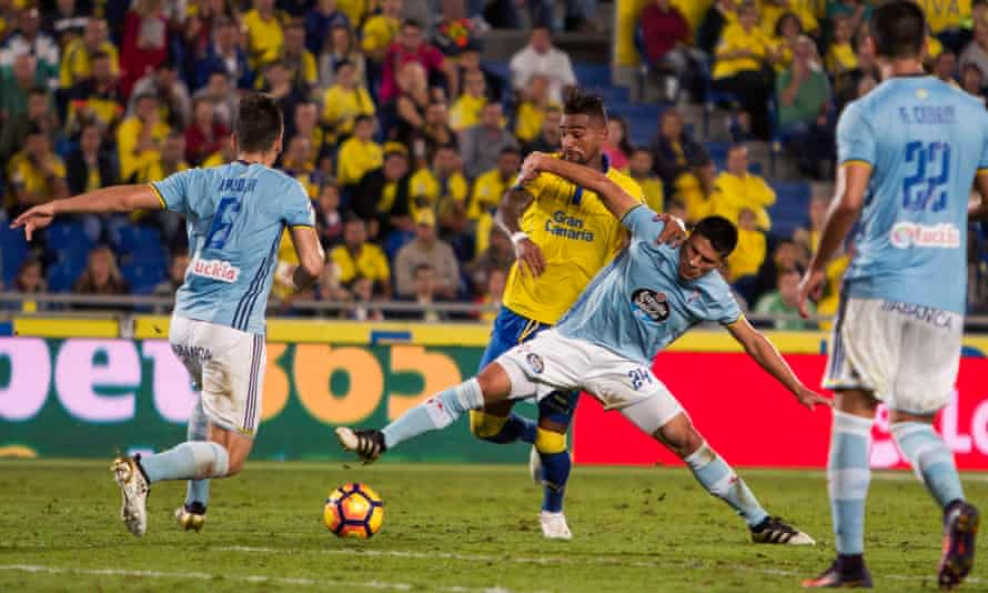 Kevin Prince Boateng fights for the ball with Celta's Argentinian defender Facundo Roncaglia.