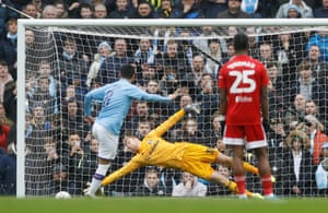 Gundogan scores City's first goal from the penalty spot.
