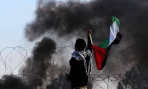 Palestinian protesters clash with Israeli forces at the Bureij refugee camp, in central Gaza.