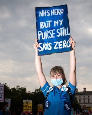 NHS workers march from St. James Park to Downing Street, London, as part of a national protest over pay.