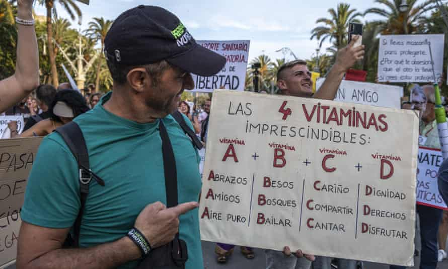 A protester with an anti-vaccine placard at a demonstration of Covid-deniers in Barcelona in July 2021.