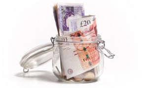 British £20 and £10 notes in savings jar