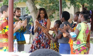 Michelle Obama washes hands with students at the RS Caulfield School girls center in Margibi County, Liberia.