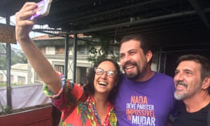 Boulos poses for photographs with artists and activists during a recent visit to Rio de Janeiro.