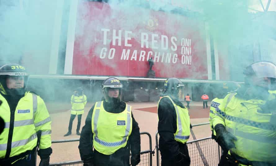 Police outside Old Trafford as fans protest against the Glazers.