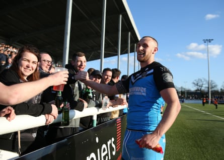 Dean Hadley celebrates with the Hull FC fans after the final whistle.