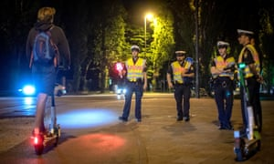 Police in Munich, one of many European cities to suffer a growing trend of 'drink-riding', stop an e-scooter user for a breath test.