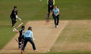 England's Kate Cross celebrates bowling out New Zealand's Katey Martin .