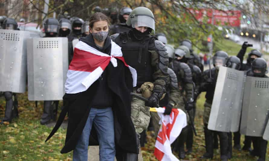 Police detain a protester during an opposition rally in Minsk on 8 November 2020