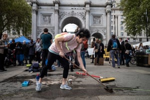 The last day is spent packing and clearing up. An activist helps clean the pavements in front of Marble Arch
