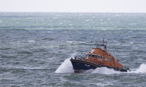 An RNLI vessel makes its way along the coastline off Dover